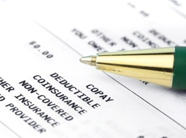 Pen on Medical insurance statement, photo by Snehitdesign/Getty Images