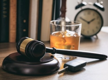 Law gavel, alcohol and car keys on a wooden desk, photo by Rawf8/Adobe Stock
