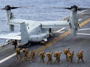Marines debark a U.S. Navy Osprey