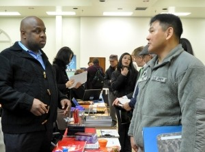 A Soldier talks to a potential employer during a job fair for transitioning servicemembers.