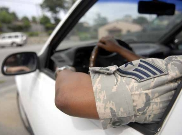 Driving with an arm out the window in tropical Air Force uniform