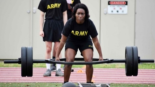 Staff Sgt. Sharonica White, assigned to U.S. Army Garrison Japan, completes a deadlift repetition during the U.S. Army Japan 2020 Army Week's Army Combat Fitness Test Fitness Warrior Competition