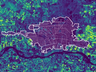A color-coded image showing the Normalized Difference Vegetation Index (NDVI) measured around Raqqah, Syria, including the city's border