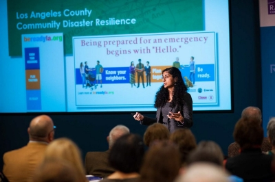 Anita Chandra presenting at Issues in Focus event