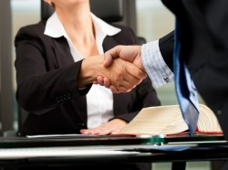 A lawyer shaking hands with someone