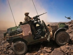 A French soldier stands guard in an armoured vehicle in the Terz valley, in northern Mali, March 21, 2013