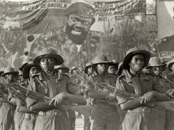 Fighters of the anti-government guerilla group UNITA parade under a portrait of their leader Jonas Savimbi, November 12, 1985, marking the 10th anniversary of Angolan Independence from Portugal