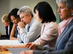 pensive business leaders in meeting