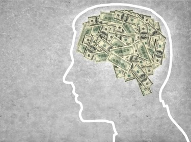 silhouette of brain made of money
