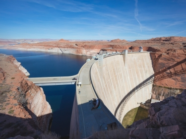 The Glen Canyon Dam in northern Arizona was built to provide hydroelectricity and flow regulation from the upper Colorado River Basin to the lower