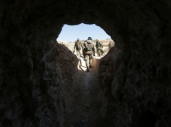 Rebel fighters walk out from a cave that was used by Islamic State militants, after they captured the area from them, on the outskirts of the northern town of al-Bab, Syria, February 2, 2017