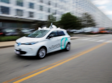 A self-driving car being developed by nuTonomy, a company creating software for autonomous vehicles, is guided down a street near their offices in Boston, Massachusetts, June 2, 2017