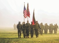 The 1st Battalion, 82nd Field Artillery Regiment, 1st Armored Brigade Combat Team, 1st Cavalry Division, color guard marches off Tower Barracks parade field after a battalion reenlistment ceremony at Grafenwoehr Training Area, Germany, Dec. 28, 2018.