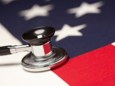 A stethoscope atop a United States flag