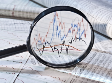 magnifying glass and charts