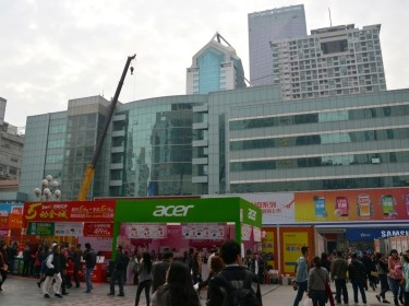 People shopping at the electronic market outside The SEG Plaza, a skyscraper named after the Shenzhen Electronics Group, in Shenzhen, China, February 1, 2015