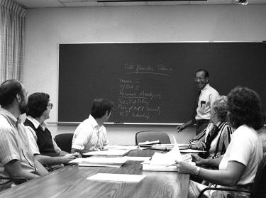 Charles Wolf teaches a RAND Graduate School class in 1980