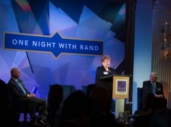 Natalie Crawford speaking at the One Night with RAND event in Santa Monica, California, November 9, 2017