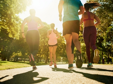 Group of people running in the park, photo by jeffbergen/Getty Images