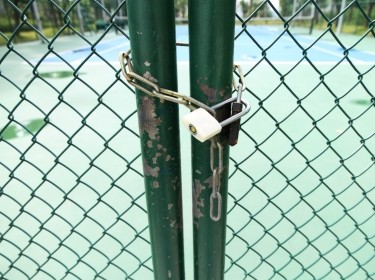 Locked entrance to a school playground