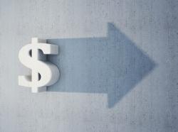 Dollar sign casting a shadow in the shape of a forward-facing arrow