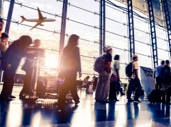 Passengers in an airport, photo by 06photo/Adobe Stock