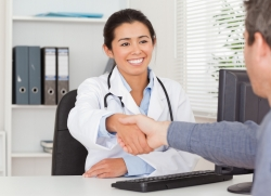 female doctor shaking patient's hand