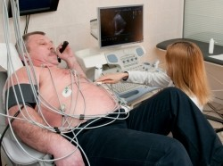 man getting his heart examined by a doctor
