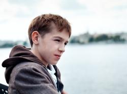 teenage boy by river