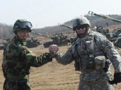 US Soldier clasps hands with ROK soldier during training exercise