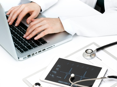 Doctor with computer and other medical technology