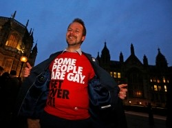 A campaigner demonstrates for a 'yes' vote to allow gay marriage, outside Parliament in London, February 5, 2013