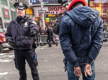 A man is hand-cuffed by the New York Police Department befor