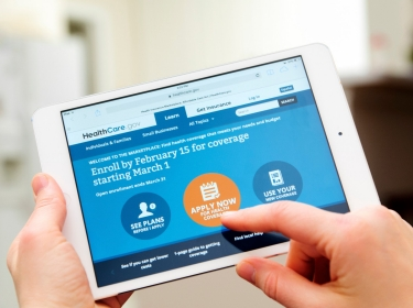 A person browsing the HealthCare.gov website on an iPad