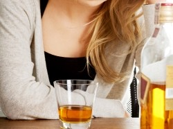 A young woman struggling with depression and alcohol abuse