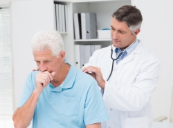 A doctor listens to a patient's breathing