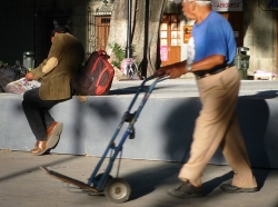 Man pushing a hand trolley
