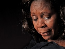 African-American woman looking down
