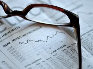 Glasses on newspaper stock market report