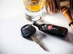 Shotglass, keys, and gavel