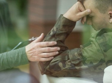 Soldier talking to mental health provider