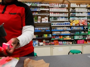Cigarettes are displayed behind the counter of a convenient store