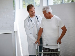 A doctor and a senior patient using a walker