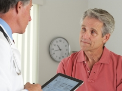 Doctor asking a senior male patient questions