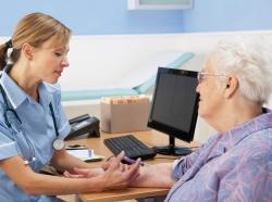 UK nurse injecting senior woman patient