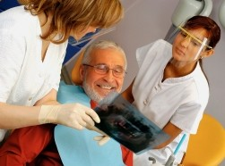 dentist with older patient