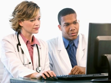 two doctors looking at a computer monitor