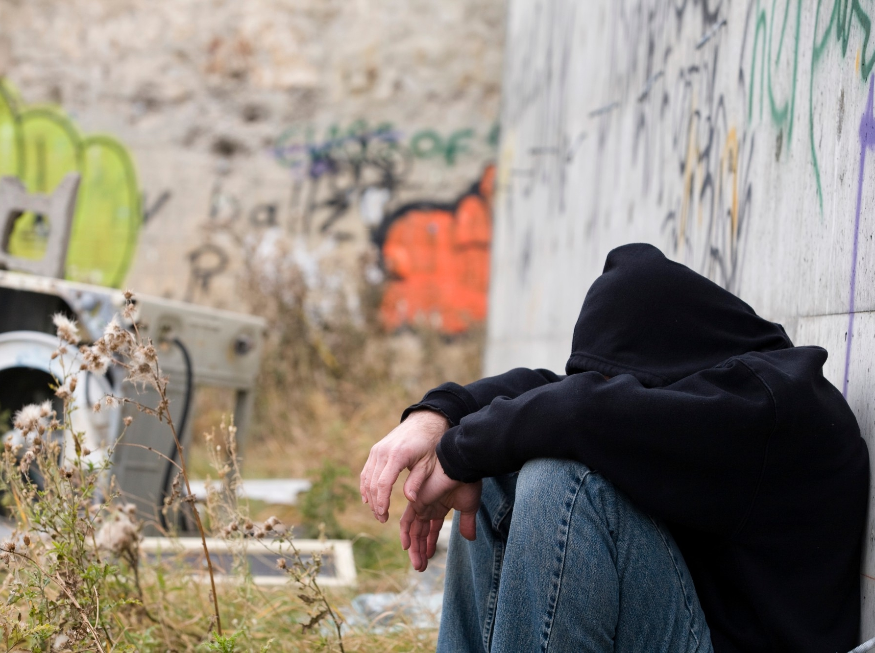 homeless man against the wall