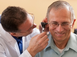 ear exam on senior patient