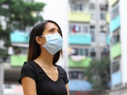 woman wearing medical face mask